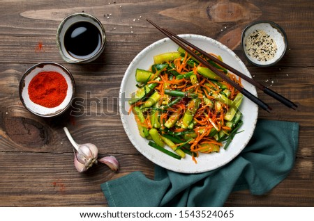 Cucumber salad with carrots and sesame seeds. Asian cuisine #1543524065
