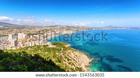 Calpe, Valencia, Costa Blanca, Spain - September 26, 2019: Calpe, Valencia, Costa Blanca, Spain - September 26, 2019: Picturesque panorama of the city from the park on Mount Ifach.  #1543563035