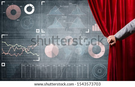 Hand opening red curtain and drawing business graphs and diagrams behind it #1543573703