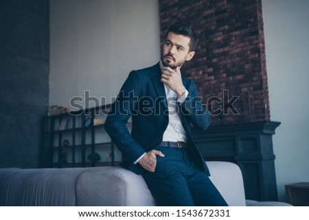 Photo of handsome business person guy sitting minded on big sofa in trendy modern trendy design apartments office building indoors wearing formalwear classy costume #1543672331