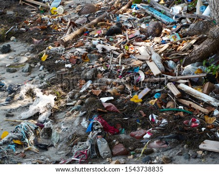 Puerto Plata, Dominican Republic, October 09. 2019: Garbage on the beach. Plastic pollution on the beach. #1543738835
