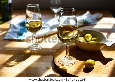 Sherry wine tasting, dry fino, manzanilla or palomino fortified wine in glasses, Jerez de la Frontera, Andalusia, Spain close up #1543782269