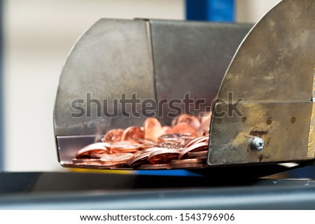 Coins manufactured and packed in money mint machine, steel galvanized with copper #1543796906