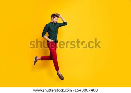 Turned ful llength body size photo of serious fashionable man with hand in red pants pocket running for sales towards barbershop for cheap service isolated vibrant color background #1543807400