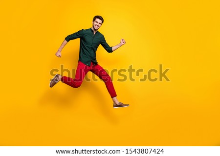 Full length body size photo of turned running jumping crazy man enjoying his run in shoes for sales in trousers isolated vivid color background #1543807424