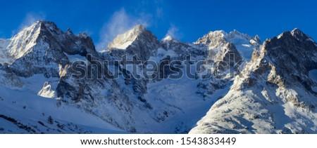 Panoramic winter view of mountain peaks of the Ecrins National Park. Pic Gaspard, Pic Oriental, La Meije and Bec de l'Homme with Glacier du Lautaret. Hautes-Alpes, Col du Lautaret, Alps, France