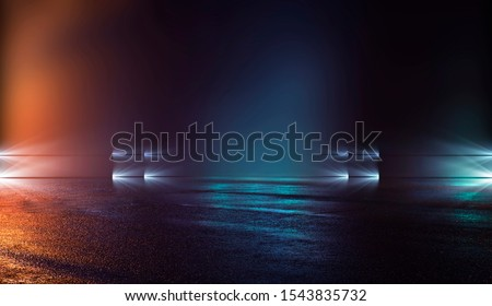 Wet asphalt, reflection of neon lights, a searchlight, smoke. Abstract light in a dark empty street with smoke, smog. Dark background scene of empty street, night view, night city. #1543835732