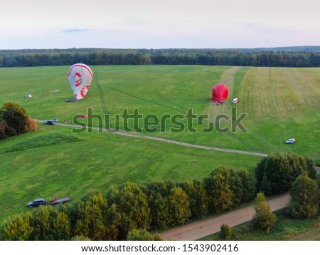 Aerial view of air balloons flights above the river.  #1543902416