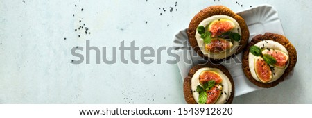 banner of healthy gluten-free vegan cakes with sesame cookie base and cashew cream. with fresh figs. healthy cuisine #1543912820