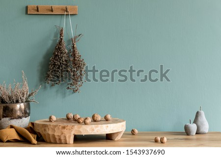 Interior design of dining room with wooden table, kitchen accessories, herbs , plants and elegant accessories. Eucaltyptus color concept. Template. Ready to use. Stylish scandinavian home decor.