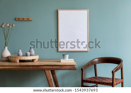 Stylish scandinavian dining room interior with mock up poster frame, wooden table, furniture, cupof coffee, flowers , cement fruits and elegant accessories. Ready to use. Template. Modern home decor.