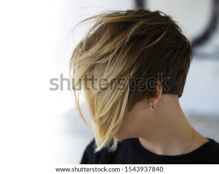 Women's haircut with active texture and disconnected zones. Royalty-Free Stock Photo #1543937840