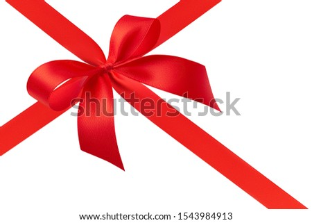 Side view of a stunning chic simple handmade luxury bow with two loops and a red bright shiny silk gift ribbon tied with a cross isolated on a white background. #1543984913