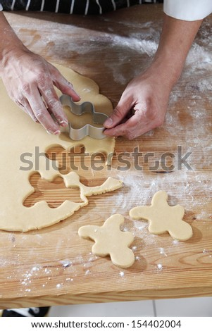 chef cutting the ginger breadman from the dough #154402004