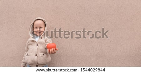 Happy little boy, red toy heart, free space text. Emotions joy happiness care, concept give love, support donation, helping children, gift life. Children's love support parenting mercy understanding #1544029844
