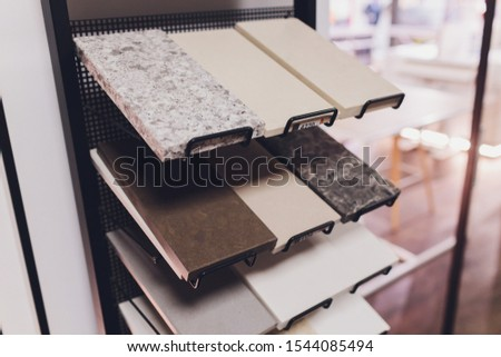 home furnishing store demonstrating variants of stone for kitchen countertop. #1544085494
