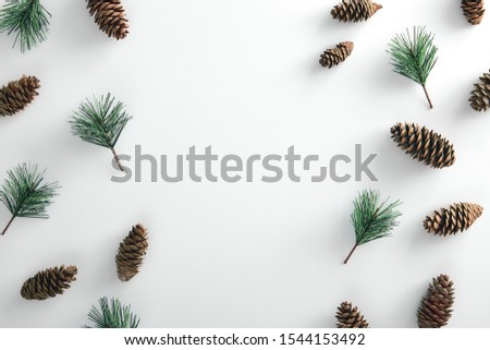 Christmas minimal concept - pattern with pinecone and pine branch on white background. Horizontal mockup with copy space, design for any purposes.. Winter christmas holiday background. Flatlay pattern Royalty-Free Stock Photo #1544153492
