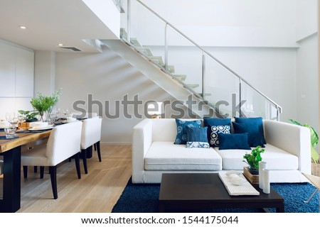 Duplex apartment by Living room interior design decorating with modern contemporary styles. Living interior space connecting with dining area. #1544175044