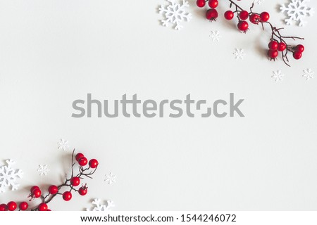 Christmas or winter composition. Snowflakes and red berries on gray background. Christmas, winter, new year concept. Flat lay, top view, copy space #1544246072