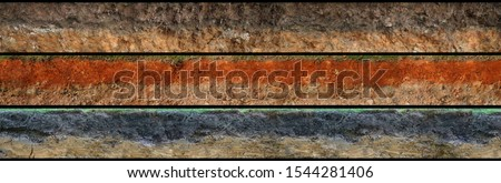 layered soil geology cross section underground earth, cutaway earth ground terrain surface Royalty-Free Stock Photo #1544281406