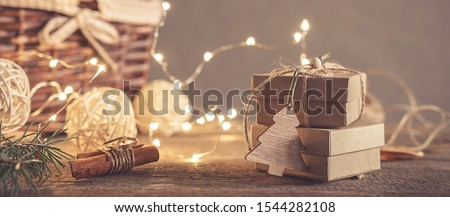 Christmas and zero waste, eco friendly packaging gifts in kraft paper on a wooden table, eco christmas holiday concept, eco decor banner #1544282108