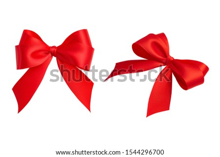 Set of two beautiful ornate perfect holiday handmade gift bows made of bright red silk ribbon taken from different angles isolated on a white background. Closeup, clipping path. #1544296700