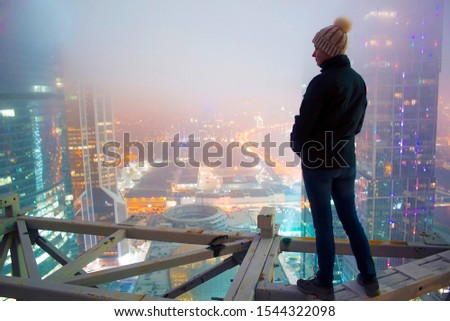 Girl posing on the roof overlooking the city #1544322098