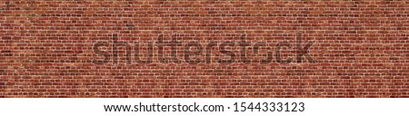 Old red brick wall background, wide panorama of masonry
