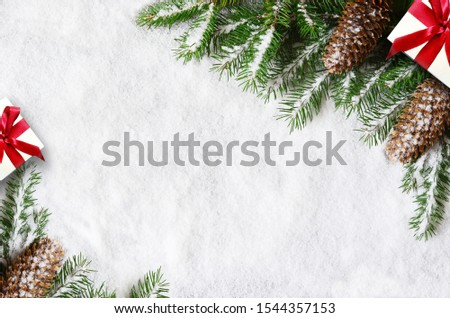 Christmas background, green pine branches, cones and gift on snow background. Creative composition with border and copy space, top view. New Year's, holiday, christmas, decoration. #1544357153