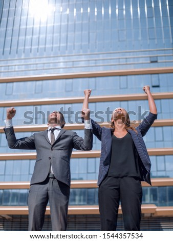 happy young professionals standing near a large office building. #1544357534