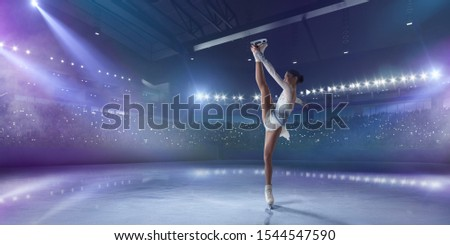 Figure skating girl in ice arena. #1544547590