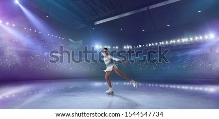 Figure skating girl in ice arena. Royalty-Free Stock Photo #1544547734