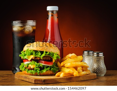 still life with fast food hamburger menu, french fries, soft drink and ketchup #154462097