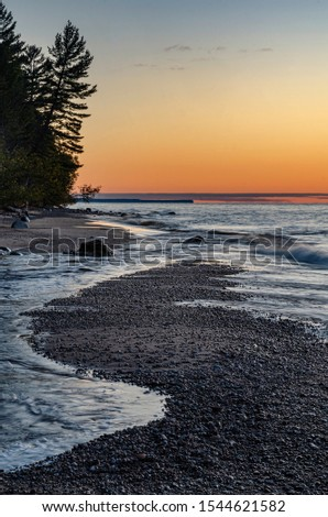 The Hurricane River flows out of the forest & takes a turn along the shore, minimizing visually the great amount of water flowing into Lake Superior, Pictured Rocks Nat'l Lakeshore, Alger County, MI