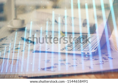 Stock market graph and table with computer background. Double exposure. Concept of financial analysis. #1544658491