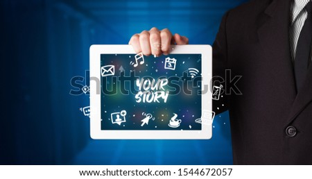 Young business person working on tablet and shows the inscription: YOUR STORY #1544672057