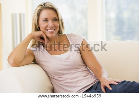 Woman sitting in living room #15446959