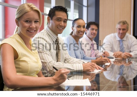 Five businesspeople in boardroom smiling #15446971