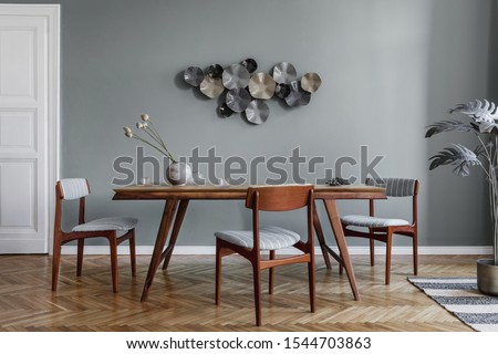 Modern dining room interior with glamour wooden table , stylish chairs and design decoration. Template. Home decor.  #1544703863