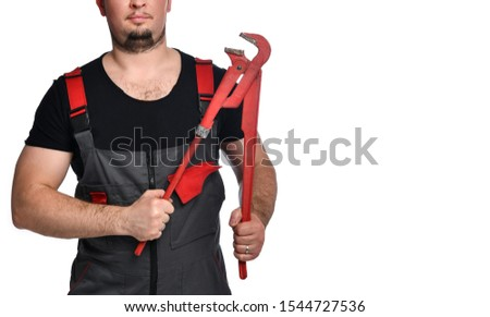 Cropped photo of a plumber with his red pipe wrench. #1544727536