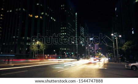 Beautiful night of Seoul road traffic, view on the busy intersection in Gangnam District. Cars, buses and other vehicles passing by creating picturesque light trails. #1544747888