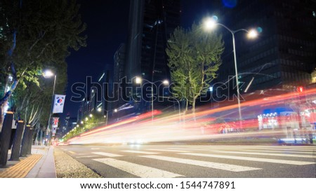 Beautiful night of Seoul road traffic, view on the busy intersection in Gangnam District. Cars, buses and other vehicles passing by creating picturesque light trails. #1544747891