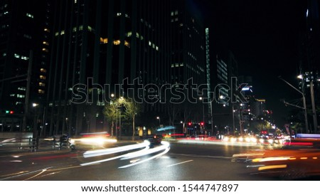 Beautiful night of Seoul road traffic, view on the busy intersection in Gangnam District. Cars, buses and other vehicles passing by creating picturesque light trails. #1544747897