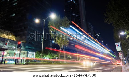 Beautiful night of Seoul road traffic, view on the busy intersection in Gangnam District. Cars, buses and other vehicles passing by creating picturesque light trails. #1544747900