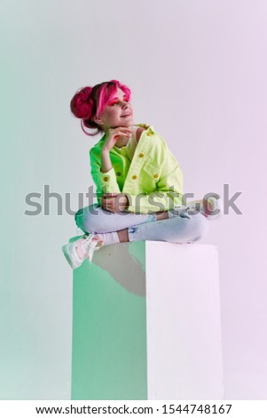 young woman in bright clothes isolated girl model background