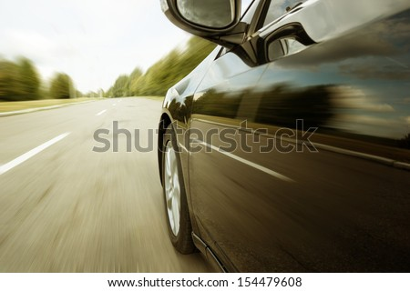 Blurred road and car, speed motion #154479608