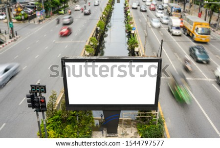 Blank advertisement billboard, mock up, information board with traffic lights  on the street. Advertising concept #1544797577