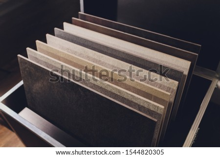 home furnishing store demonstrating variants of stone for kitchen countertop. #1544820305