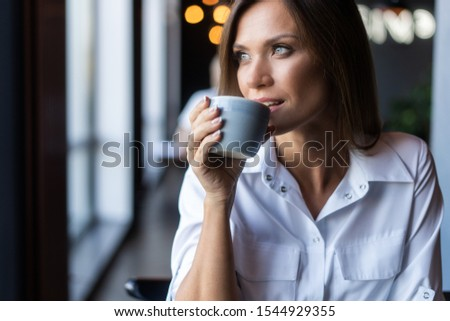 Portrait of happy brunette woman drinking coffee in the morning at restaurant #1544929355