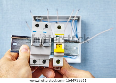 The automatic fuse Installing. In the event of overload or a short-circuit, miniature circuit breakers or  MCB safely cut the connected circuits and  protect electrical systems and devices of damage. #1544933861
